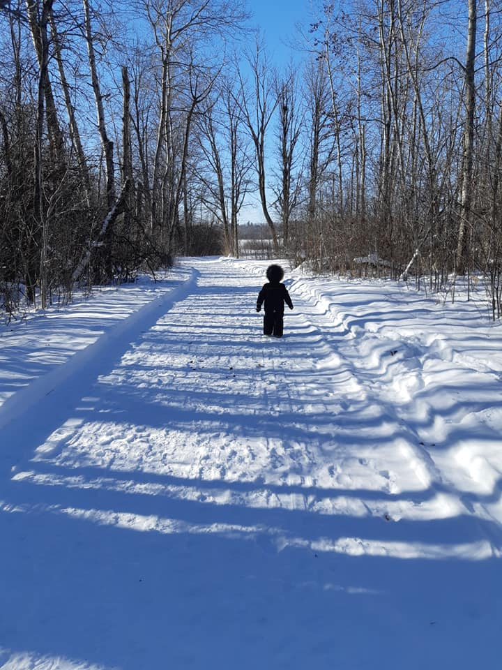 Child walking on the Ma-te-Way Fitness Trail in the winter.